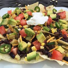 Veggie Nachos! This is my plate... #glutenfree #vegan nachos loaded with summer #veggies!  Sautéed Zuchinni, Red Onion & Black Beans, Fresh Corn, Tomatoes, Avocado & Jalapeño Pepper, @daiyafoods cheese and @tofuttibrands sour cream.  Recipe adapted from @cookinglight.  My son's plate had lots more cheese with the veggies hidden beneath.  Both were YUMMY!
