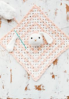 This snuggly crochet bunny baby lovey is simple to make, and perfect for gifts for babies and toddlers alike! The free pattern is a quick and easy project. Bunny Crochet, Crochet Lovey, Love Crochet, Crochet For Kids, Crochet Dolls, Crochet Yarn, Blanket Crochet, Crochet Things, Crochet Animals