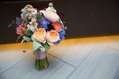 Mokara Floral Design   Relaxed Compact summer bouquet juliet garden roses purple hydrangea freedom roses peach purple bouquet   Mandi Paige Photography