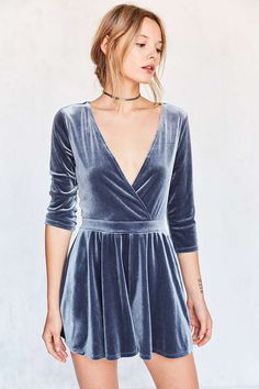 Party-perfect deep-V velvet surplice romper with 3/4-length sleeves by Silence + Noise. In super soft stretch velvet with an easy pull-on fit featuring loose shorts that taper out from a cinch-banded waist. Finished with a plunging wrap-front neckline perfect for showcasing accessories.