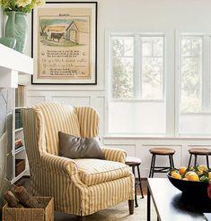 Slip covered chair, framed cow poster