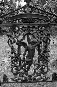 Iron gate in Watts Cemetery, Nevada County, Arkansas, manufactured by an unnamed Ohio company.  There were numerous companies located in Ohio which supplied wrought iron to cemeteries across the country from the mid-1800's to the early 1900's.