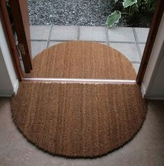 Cut a large rectangular coir mat into two to make a great transition from out to in. For the garage and back entries.