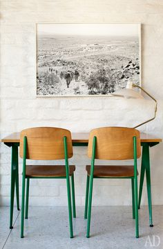 Double desk in bright green and brich wood in a mid century modern house in Palm Springs. Airy and cool.