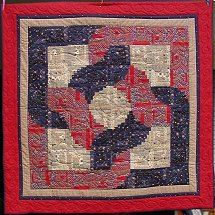 from heart to heart log cabin quilt - wish this was larger to see the intricacy of this lovely quilt