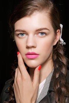 hot pink lipstick with bright red nails