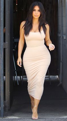 Kim Kardashian in a nude tight bodycon midi dress