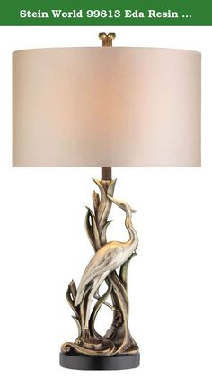 Stein World 99813 Eda Resin Table Lamp, Silver/Green. The majestic beauty of the crane as it nest amongst the wetlands is beautifully depicted in the eda table lamp . Statuesque and exuding style, the amazing visual display of this decorative lamp is usually only seen in museums. The base of the lamp is bronze and the display itself is two toned in antique gold and silver, it's completed with a silver silk hardback oval shade and coordinating finial.
