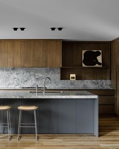 Minimalist kitchen designed by Flack Studio.