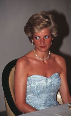 Princess Diana, looking quite suntanned.