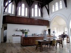 Gorgeous rustic kitchen & dining area in a converted church home in London. Love the enormous scale of this space. Chapel Conversion, Church Conversions, Church Interior, Boho Home, Old Churches, Church Building, Big Houses, Rustic Kitchen, Kitchen Dining