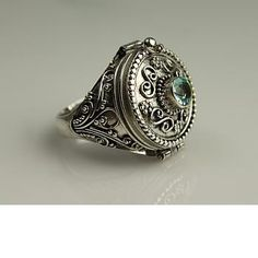 I wish I could get this with my birthstone, a peridot, in the middle.