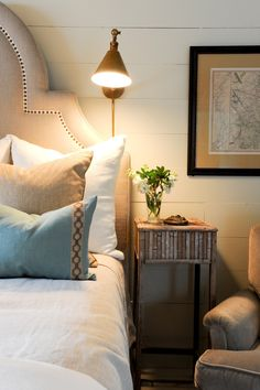For bedrooms that require tiny nightstands, mount a wall sconce. When side table real estate is scarce, we fully support using it for flowers instead of a lamp. See more at Number Four Eleven »  - GoodHousekeeping.com