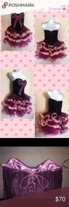 Betsey Johnson Purple Velvet Tutu Dress Heart shaped bodice made with a deep purple velvet. Bow on the bodice is made of lace and sequins. Full tutu skirt lined with wired ribbon. Ribbon on each layer is ombre purple to pink. Tutu layers change from purple to burgundy to fusia. Absolutely beautiful! Corset backing to adjust the size for preference. Zipper on left side. Shell 1 made of 100% nylon, shell 2 is made of 82% rayon and 18% silk and the lining is made of 100% polyester. Dry clean…
