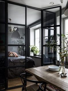 Stylish Black Glass Doors In The Small Magnificent Flat Interior! Doors Separate Tiny Rustic Kitchen And Bedroom. Maybe It Is Little Dark Interior But I Still Love It!