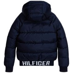 Boys navy blue jacket by Tommy Hilfiger, made with a silky feel polyester. In a puffer style it is padded and has a silky lining. The collar, cuffs and hem are ribbed, it has a padded hood and a high fastening zip. A lovely warm jacket, with fleece lined pockets and an embroidered flag logo on the chest.