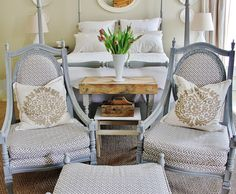 Fun ideas for decorating for spring.  Love the neutrals with a pop of color with the tulips and that pallet wood table is amazing.  thistlewoodfarms.com