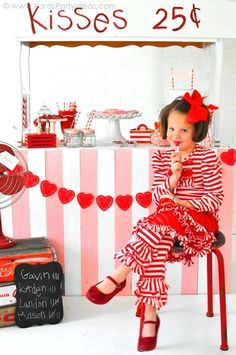 Valentine's party kissing booth via Kara's Party Ideas red and white stripe outfit for little girl