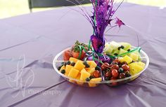 Centerpieces...Clear tray + balloon weight from dollar store and fruit. Better to pick at than chips!