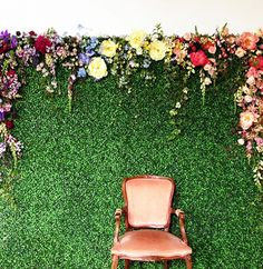 Create a Kodak moment: A hedge wall with cascading flowers is the perfect photo opportunity at a party.