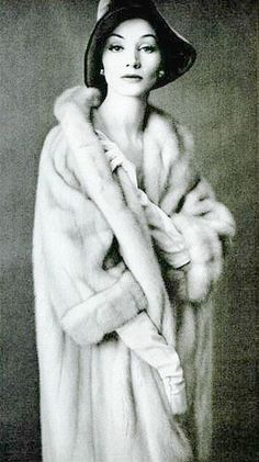 Model is wearing a natural blonde mink coat by Fredrica, 1960