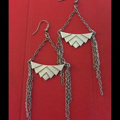 FREE PEOPLE EARRINGS - NWT Great earrings for any occasion and any season.  Tribal look with chains hanging down.  Purchased directly from Free People. NWT  No hold, or trades; price is firm. Free People Jewelry Earrings