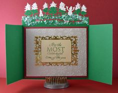 Gini Williams Cagle designing for @CraftersCompUS (card open) Die'sire Edge'ables ChristmasGarden Stamp Set: Stamp It Australia Holiday - Wonderful Time; Frosty Morning Embossing Folder Die'sire Classiques Christmas - Elegant Reindeer; Scenic Pines Die'sire Prestige Dies - With Great Love Shimmering Cardstock - White Pearl, Red Pearl
