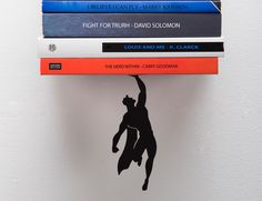"'Supershelf', one of the products in the ""Falling books"" series, is a cool floating #shelf which gives the impression of a #superhero holding the books afloat, preventing them from falling to the ground."