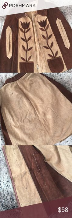 Vintage Suede Poncho Boho Chic! This Brown on Brown Suede Poncho was just pulled out of the archives and is in Mint Condition! Ready for Fall Festival Season! This One Size Throw Over The  shoulders has a zip front and slits on the sides for arms. No Label or Size Tag. No signs of wear as it's been sitting in storage. Has small tear on the inside. See all photos. Needs dry cleaning-reflected in the price. Vintage Jackets & Coats Capes