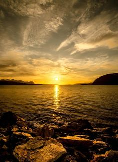 'The Midnight Sun'- The midnight sun shines over the Reisafjord in Norway at 1am;  it's called the midnight sun because the sun doesn't set/rise during the mid-summer within the polar circle;  photo by *torivarn on deviantART