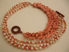Wave Walker Necklace: Egyptian coil paired with shells and seedbeads in different coral tones.