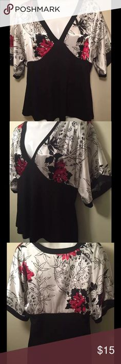 AGB Black Silky Red Floral Asian Style Blouse AGB  • V-neck kimono style blouse • Bamboo and leaves and red flowers detail • 24in from shoulder top to hem • 19 in from armpit to armpit, silky/satin feel AGB Tops Blouses