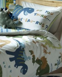 Dino features an array of dinosaurs printed throughout the front of the duvet cover and pillow case with a subtle striped reverse. Set comprises of duvet cover and one pillowcase Kids Bedding Sets, Duvet Sets, Duvet Cover Sets, Dinosaur Bedding, Dinosaur Bedroom, Boy Toddler Bedroom, Kids Bedroom, Toddler Boys, Bed Curtains