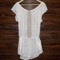 FREE PEOPLE Romper Crochet Inset Bohemian Jumpsuit Size M/L. New With Tags. $188 Retail + Tax.    Bohemian off-the-shoulder romper with elastic shoulder band & waist.  2 side hip pockets.  Shorts are lined. By ESC for Free People.   Cotton, Linen, Rayon, Polyester.  Imported.     ❗️ Please - no trades, PP, holds, or Modeling.    Bundle 2+ items for a 20% discount!    Stop by my closet for even more items from this brand!  ✔️ Items are priced to sell, however reasonable offers will be…