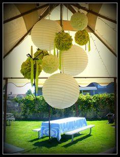 chandelier of pom poms and lanterns
