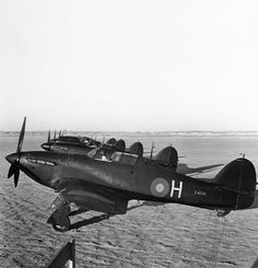 Hawker Hurricane Mark Is (Z4204 'H' nearest) of 'B' Flight, No. 30 Squadron RAF, lined up at Idku, Egypt, while operating in the night fighter role for the air defence of Alexandria.