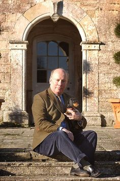 Downton Abbey creator Julian Fellowes at his home in Dorset.  With the family dachshund.
