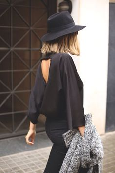 Amazing cowl back black drapey top, fedora and a chunky knit jumper