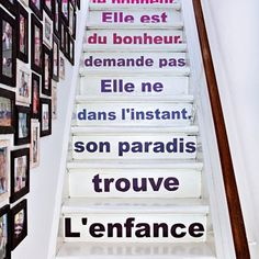 Stairs of jewelry designer Sandrine Zigler-Munck's house. Decorated with letter stickers (great idea!) of a quote from write Louis Pauwels.