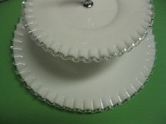 Fenton Glass Silver Crest White Ruffled Two Tiered Tray. The top plate measures 8 1/2 and the bottom plate measures 12 1/2. The tray is 11