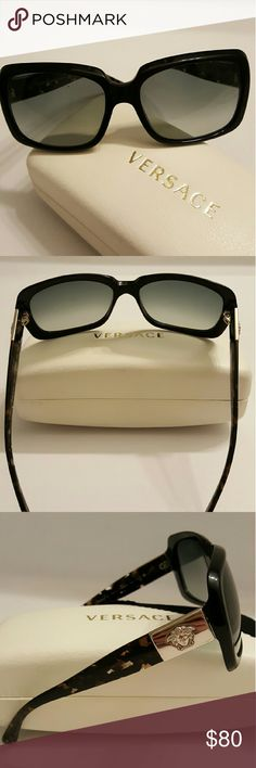 Versace Womens Sunglasses MODEL 4190 Womens Versace sunglasses model 4190. Front of glasses are solid black and sides have a gold versace emblem and are tortuous colored. Serial number BV2642443. Has mild wear on inside of nose bridge area shown in picture and has mild scuff on lens. Comes with cleaning cloth and original box. Versace Accessories Sunglasses