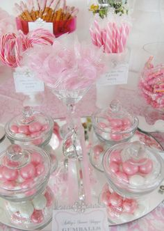 This pink and white themed candy buffet is divine!  Never be afraid of filling several different jars with the same candy - it will add dimension as well as cohesiveness to your buffet.