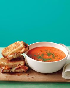 Tomato Soup with Bacon Grilled Cheese   Martha Stewart Living - This classic combo stirs pesto (or salsa verde) into the tomato soup and adds bacon to the grilled cheese sandwich for an ideal lunch or dinner for one.