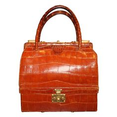 Hermes Crocodile Sac Mallet  | From a unique collection of antique and modern trunks and luggage at http://www.1stdibs.com/furniture/more-furniture-collectibles/trunks-luggage/