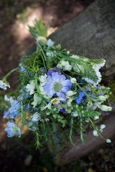 Seasonal September bridal bouquet with scabious, larkspur, nigella and rosemary // Flowers by In Bloom Devon www.inbloomdevon.co.uk // Photography by Emma Stoner www.emmastonerweddings.com // The Natural Wedding Company