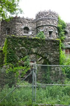 The once-proud Hearthstone Castle sits abandoned in Danbury's scenic Tarrywile Park, a forgotten edifice now boarded up and home to tangled weeds and various opportunistic critters. It was built in 1897  abandoned in 1985.