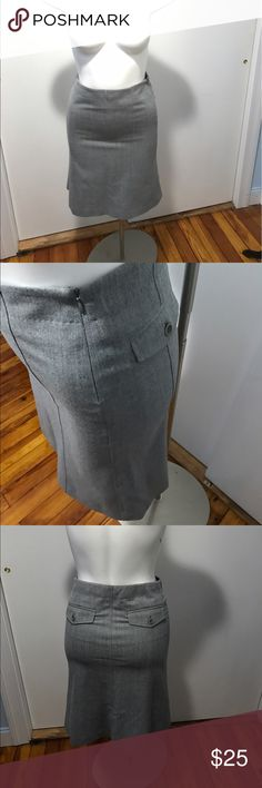 Theory grey pencil straight skirt Nice theory skirt that is labeled a 2 but has a 29 inch waist so fits more like a 4/6. It is fully lined, has a side zip and back pockets. It has some marks on the front of you look closely that should come out with a cleaning. Theory Skirts Pencil