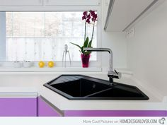 This modern modular kitchen sure is stunning and really attractive to the eye. The purple color of the cabinets complement well with the white counters and black corner kitchen sink. #kitchensinks