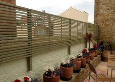 The Garden Trellis Company manufacture bespoke gates, gazebos, garden furniture, planters, contemporary slatted panels and and many more Garden Joinery products. Diy Garden Fence, Vertical Garden Wall, Garden Privacy, Garden Trellis, Wooden Garden, Privacy Trellis, Trellis Fence, Privacy Fences, Back Garden Design