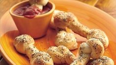 Twist refrigerated breadsticks into bone shapes for a hauntingly delicious Halloween snack.